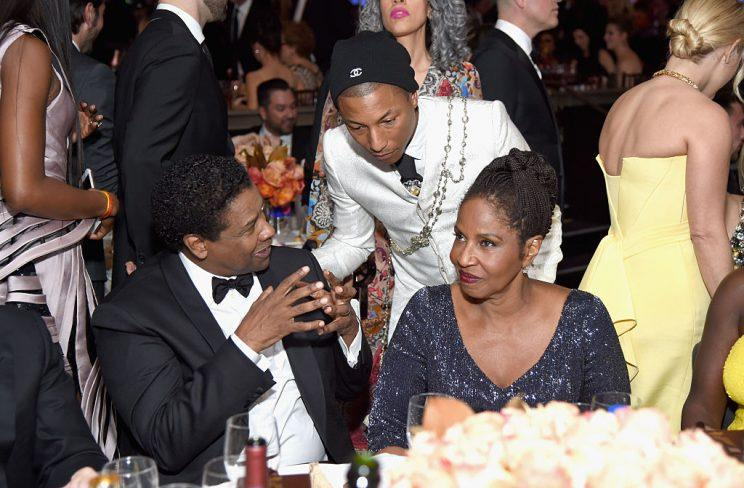 Stars paid their respects to Denzel Washington; here, he's talking to Pharrell. (Photo: Getty Images)