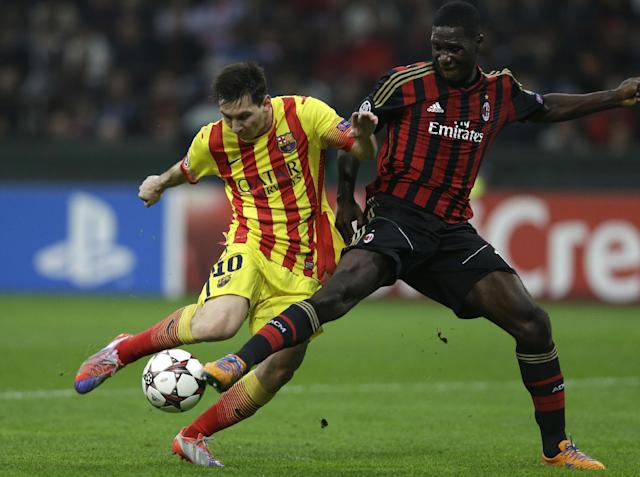 Barcelona's Lionel Messi duels for the ball with AC Milan's Cristian Zapata, right, during a Champions League, Group H, soccer match between AC Milan and Barcelona at the San Siro stadium, in Milan, Italy, Tuesday, Oct. 22, 2013. (AP Photo/Luca Bruno)