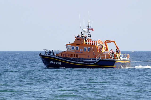 An RNLI All Weather off shore Lifeboat in Weymouth bay out on a search and rescue mission