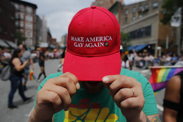 <p>A reveler shows off his hat mirroring President Trump's campaign slogan Make America Great Again at the annual Pride Parade on June 24, 2018 in New York City. (Photo: Kena Betancur/Getty Images) </p>