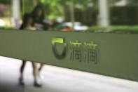 Sign of Chinese ride-hailing service Didi is seen at its headquarters in Beijing