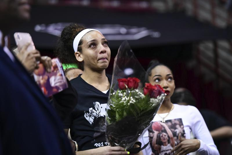 South Carolina forward Mikiah Herbert Harrigan cries before being introduced for senior day before an NCAA college basketball game against Texas A&M Sunday, March 1, 2020, in Columbia, S.C. (AP Photo/Sean Rayford)
