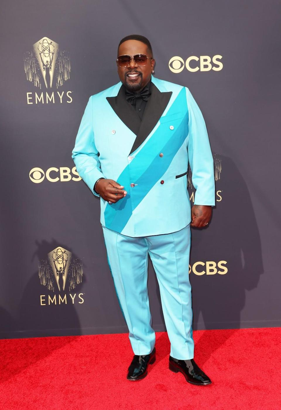 A man on the red carpet in a light-blue suit
