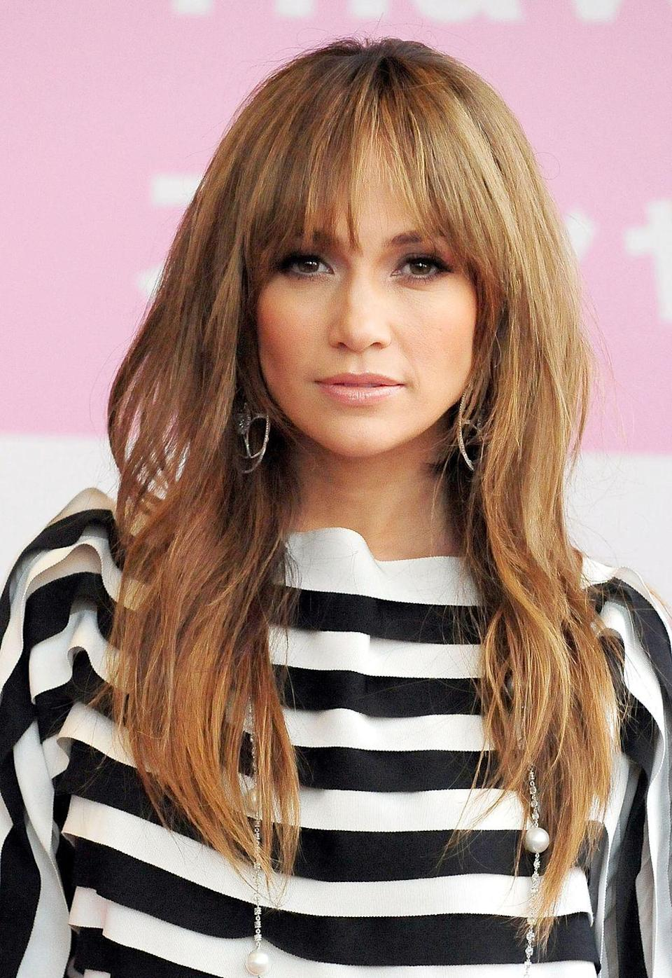 <p>Bring a Brigitte Bardot-esque touch to your shaggy long locks with wispy bangs. Just make sure to blow them out after shampooing — frizzy bangs are the opposite of what you want with this look.</p>