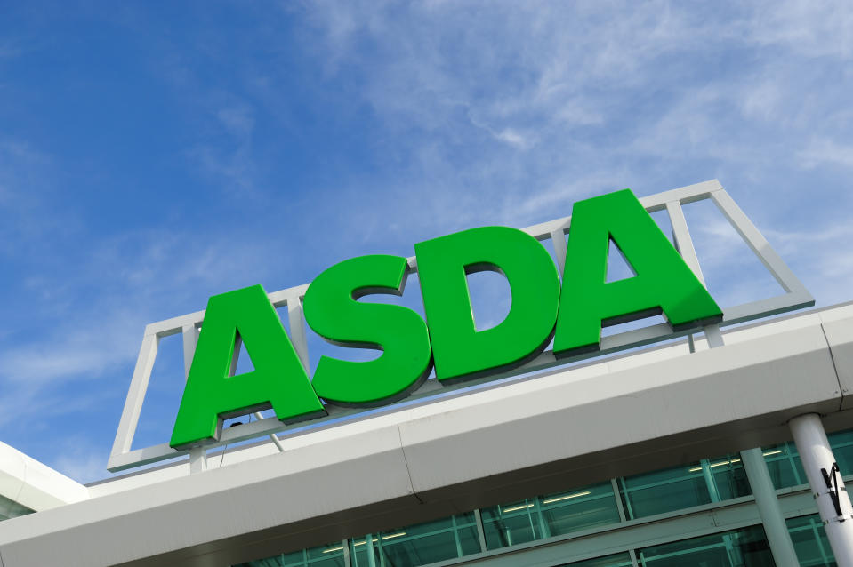 Birmingham, England - March 14, 2011: Asda sign on storefront. Asda is a British supermarket chain which retails food, clothing, toys and general merchandise. Asda became a subsidiary of the American retail giant Wal-Mart, the world\'s largest retailer in 1999.