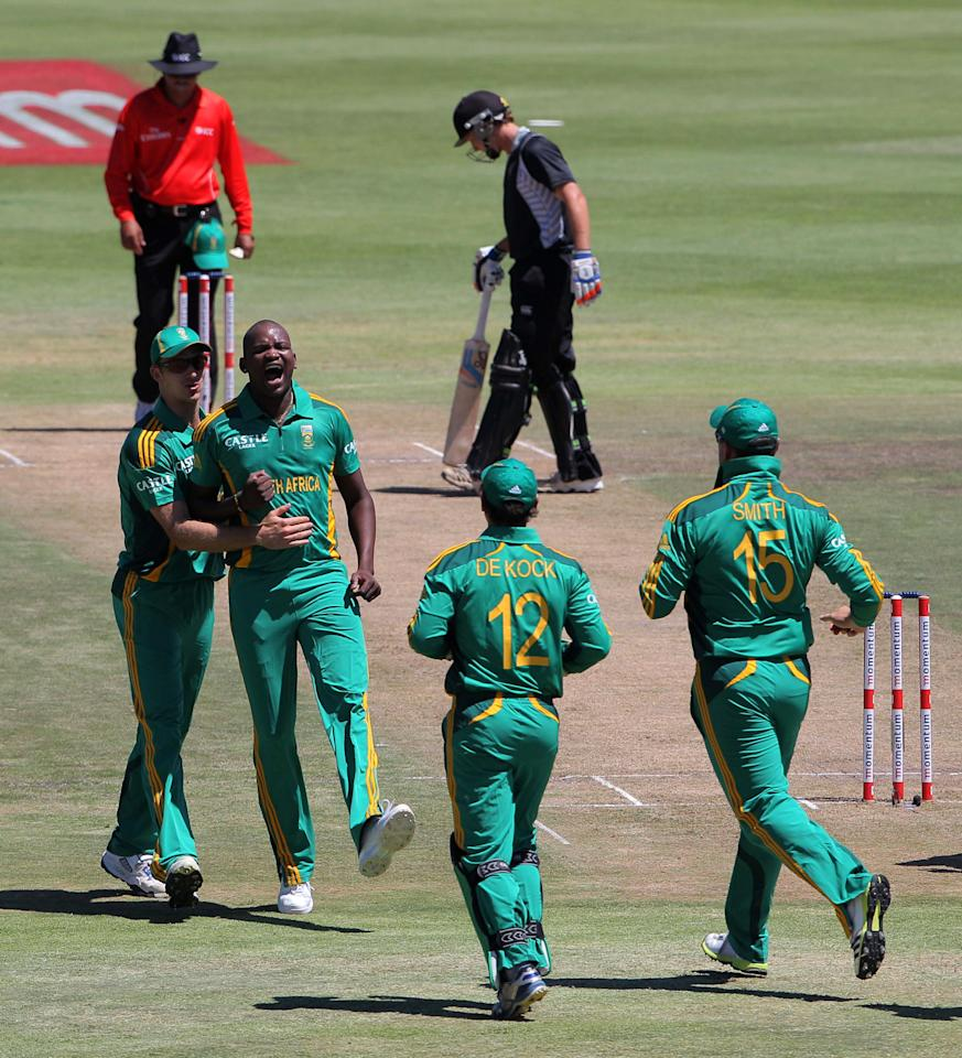 PAARL, SOUTH AFRICA - JANUARY 19: Lonwabo Tsotsobe (2nd L) of South Africa celebrates a wicket during the 1st One Day International match between South Africa and New Zealand at Boland Park on January 19, 2013 in Paarl, South Africa.  (Photo by Carl Fourie/Gallo Images/Getty Images)
