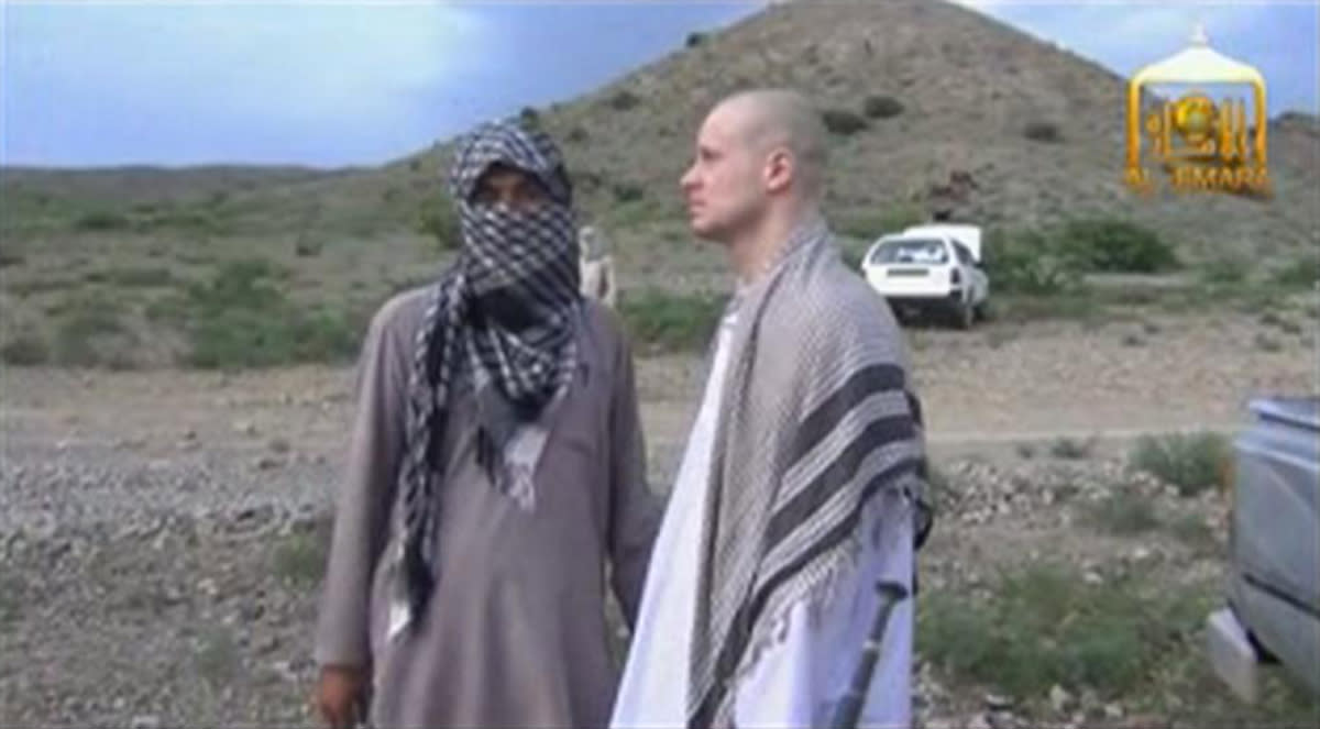 U.S. Army Sergeant Bowe Bergdahl (R) waits before being released at the Afghan border, in this still image from video released June 4, 2014. The Taliban have released the 17-minute video showing the handover of Bergdahl to the American military close to the Afghan border with Pakistan, in an exchange for five militants held at U.S. jail Guantanamo Bay, Cuba. The video shows a Bergdahl, clean shaven, dressed in a white salwar kameez and with a shaved head, waiting in a pick-up truck as Taliban militants outside lean in to talk to him. He appears to blink in the bright light, assenting as they speak. The video's authenticity could not be independently verified. REUTERS/Al-Emara via Reuters TV (AFGHANISTAN - Tags: POLITICS MILITARY TPX IMAGES OF THE DAY) ATTENTION EDITORS - THIS PICTURE WAS PROVIDED BY A THIRD PARTY. REUTERS IS UNABLE TO INDEPENDENTLY VERIFY THE AUTHENTICITY, CONTENT, LOCATION OR DATE OF THIS IMAGE. FOR EDITORIAL USE ONLY. NOT FOR SALE FOR MARKETING OR ADVERTISING CAMPAIGNS. NO SALES. NO ARCHIVES. THIS PICTURE IS DISTRIBUTED EXACTLY AS RECEIVED BY REUTERS, AS A SERVICE TO CLIENTS