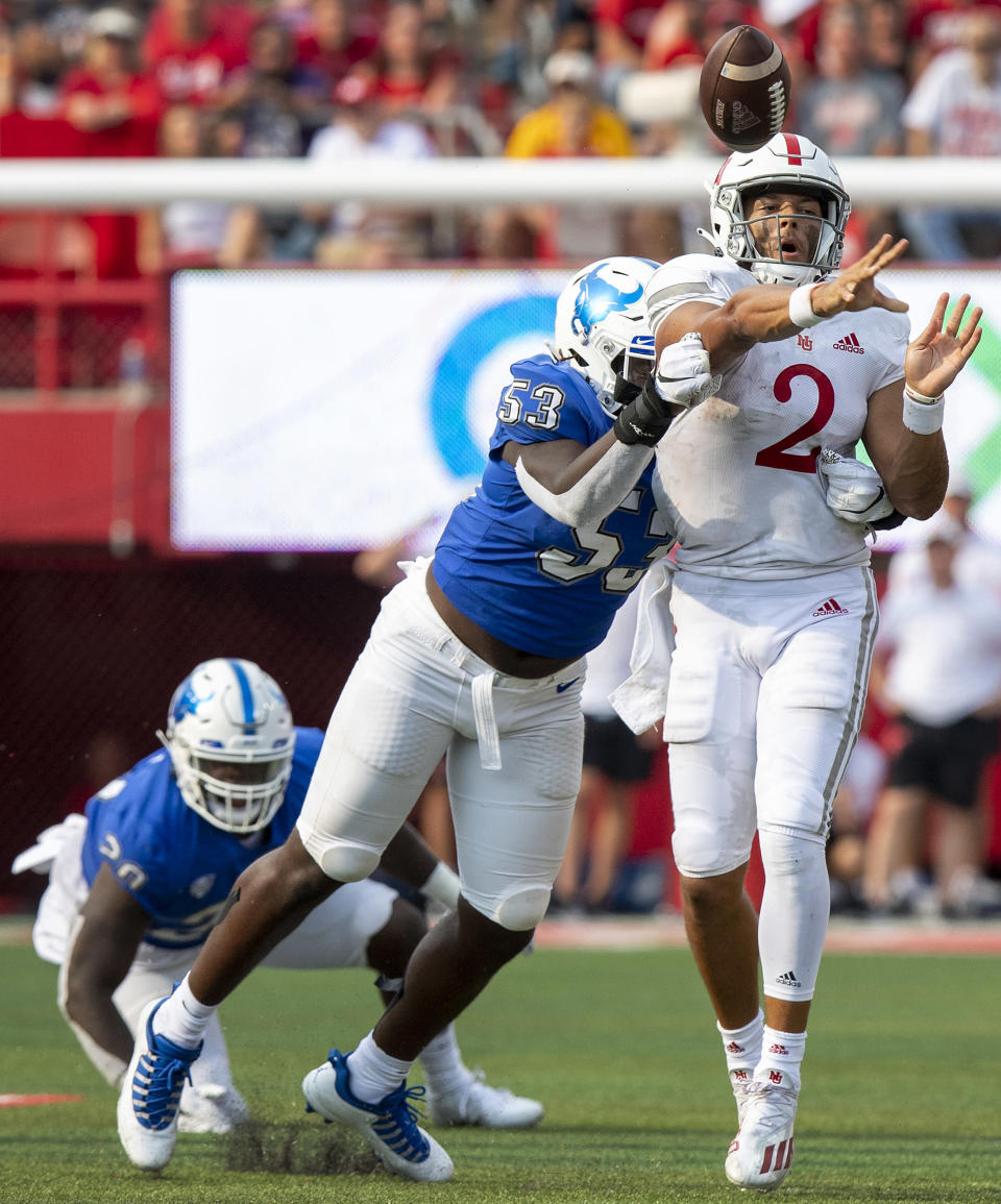 Nebraska quarterback Adrian Martinez (2) gets hit by Buffalo's C. J. Bazile (53) as he throws in the third quarter of an NCAA college football game Saturday, Sept. 11, 2021, in Lincoln, Neb. (Francis Gardler/Lincoln Journal Star via AP)