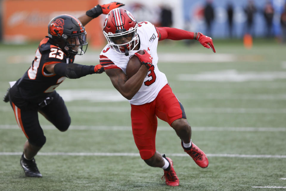 Utah wide receiver Demari Simpkins (3) dodges a tackle from Oregon State defensive back Isaiah Dunn (23) during the first half of an NCAA college football game in Corvallis, Ore., Saturday, Oct. 12, 2019. (AP Photo/Amanda Loman)
