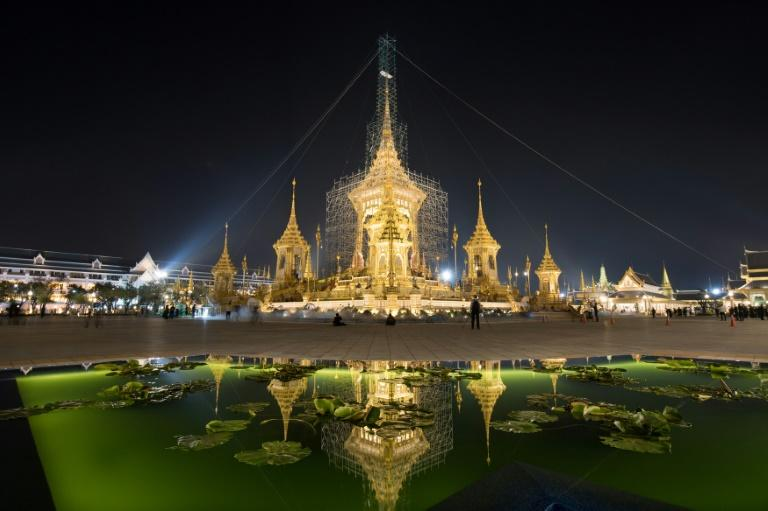 The cremation site for Thailand's late king Bhumibol Adulayadej's reflected in a lotus pool
