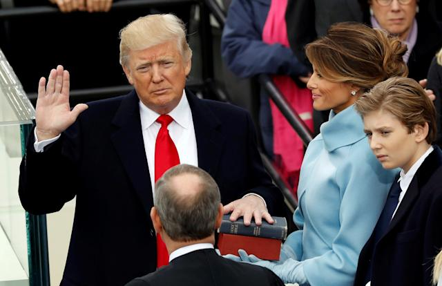 U.S. President Donald Trump takes the oath of office on Jan. 20, as protesters demonstrated in downtown Washington. (Kevin Lamarque/Reuters)