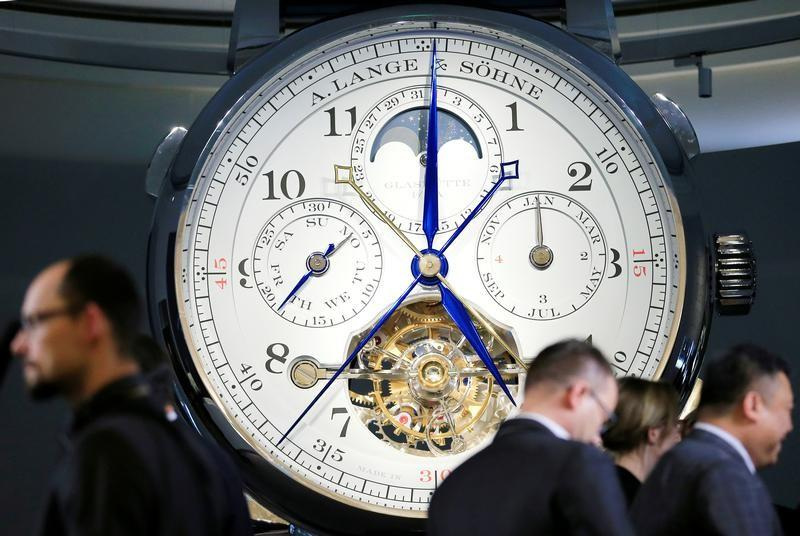 Visitors view the A. Lange & Soehne stand during the opening day of the SIHH fair in Geneva