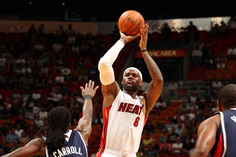 MIAMI, FL - OCTOBER 7: LeBron James #6 of the Miami Heat shoots a jumpshot against the Atlanta Hawks during a game on October 7, 2013 at American Airlines Arena in Miami, Florida. (Photo by Issac Baldizon/NBAE via Getty Images)