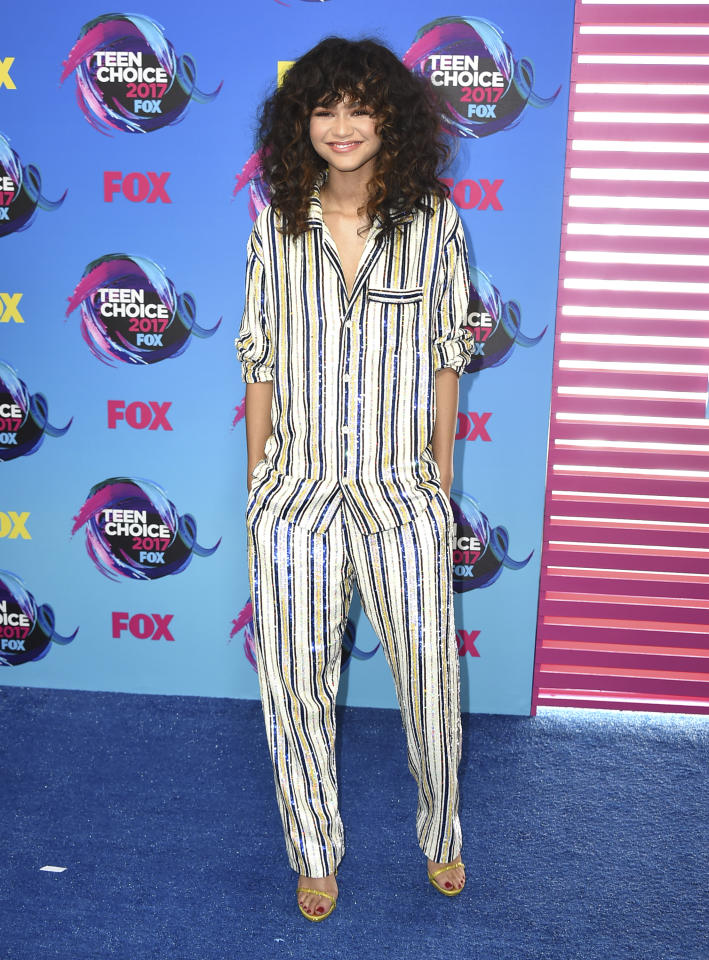 <p>Zendaya kept things casual in a striped pyjama suit by British designer Ashish.<br /><i>[Photo: Getty]</i> </p>