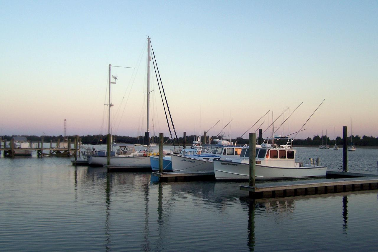 """<p>This small town located in coastal North Carolina is a favorite of Southerners from near and far, who appreciate its relaxed atmosphere, fun shops, and easy access to the water. If you're wondering, it's pronounced """"BOW-fert.""""</p> <p>Learn more about <a href=""""https://www.southernliving.com/souths-best/beaufort-nc"""">Beaufort</a>. </p>"""