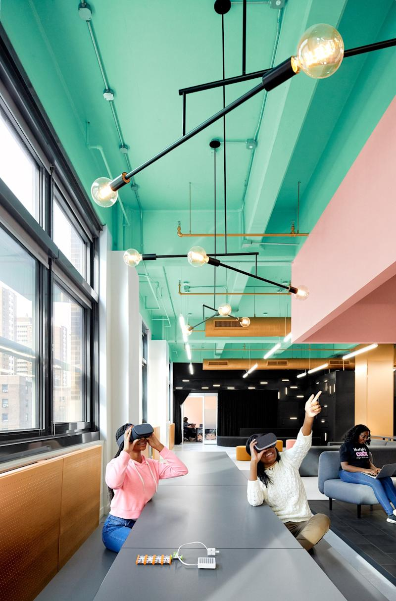 The space was designed with brightly colored walls that encourage the girls to interact with it.