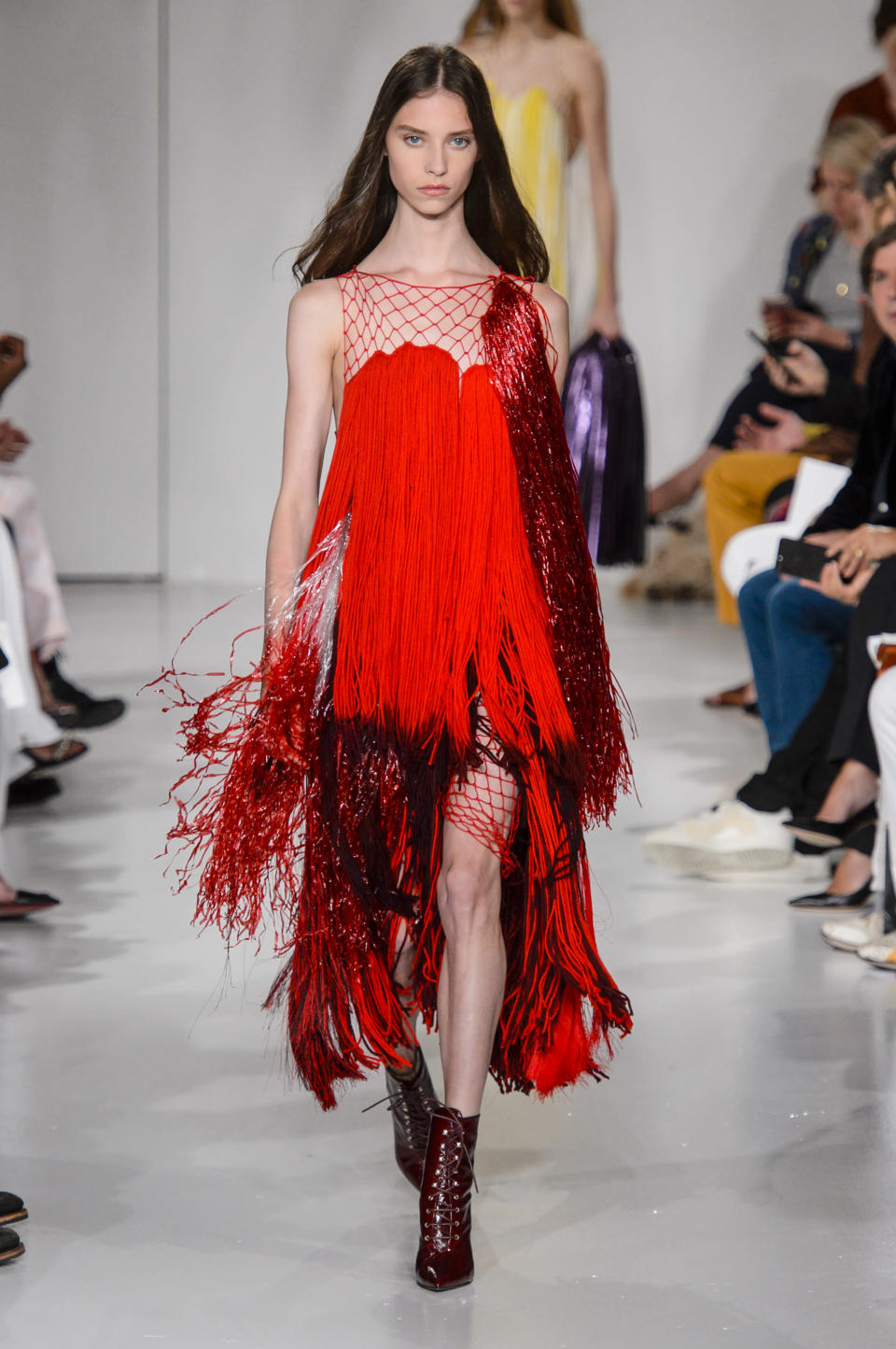 <p><i>Model wears a red-fringe dress from the Calvin Klein SS18 collection. (Photo: IMAXtree) </i></p>