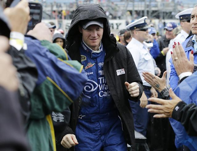 Dale Earnhardt Jr., greets fans during driver introductions before the NASCAR Sprint Cup series auto race at Chicagoland Speedway in Joliet, Ill., Sunday, Sept. 15, 2013. (AP Photo/Nam Y. Huh)