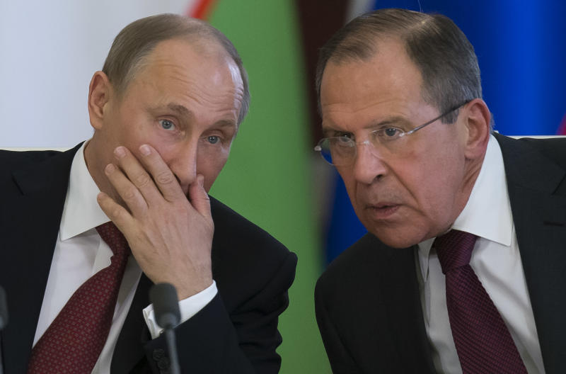 Russian President Vladimir Putin, left, listens to Foreign Minister Sergey Lavrov during a signing ceremony after Russia Uzbek talks in Moscow's Kremlin,  Russia, Monday, April 15, 2013. Lavrov said that Tom Donilon, President Barack Obama's national security adviser who met with Putin Monday to hand him a letter from Obama, said that the U.S. administration wants to overcome the current strain in relations with Russia. (AP Photo/Alexander Zemlianichenko)
