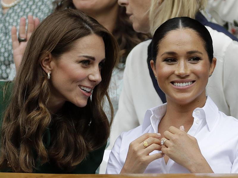Kate, Duchess of Cambridge, left, and Meghan, Duchess of Sussex chat as they sit in the Royal Box on Centre Court to watch the women's singles final match between Serena Williams of the United States and Romania's Simona Halep on day twelve of the Wimbledon Tennis Championships in London: AP