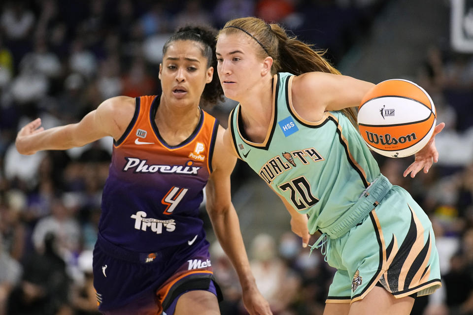 New York Liberty guard Sabrina Ionescu (20) drives past Phoenix Mercury guard Skylar Diggins-Smith during the second half in the first round of the WNBA basketball playoffs, Thursday, Sept. 23, 2021, in Phoenix. Phoenix won 83-82. (AP Photo/Rick Scuteri)