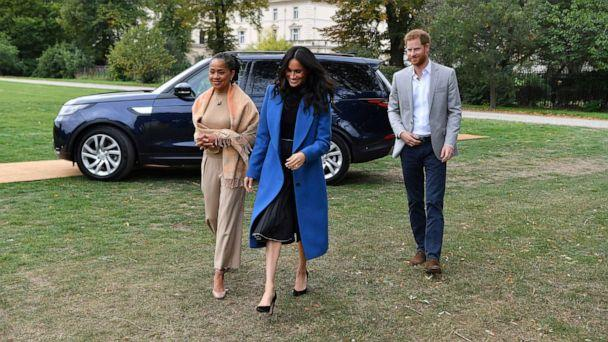 PHOTO: In this Sept. 20, 2018, file photo, Meghan, the Duchess of Sussex, accompanied by Prince Harry, the Duke of Sussex and her mother Doria Ragland, walk to attend a reception at Kensington Palace, in London. (Ben Stansall/AP, FILE)