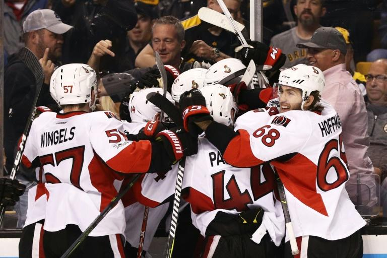 Members of the Ottawa Senators celebrate with Clarke MacArthur after he scored the game winning overtime goal to defeat the Boston Bruins on April 23, 2017