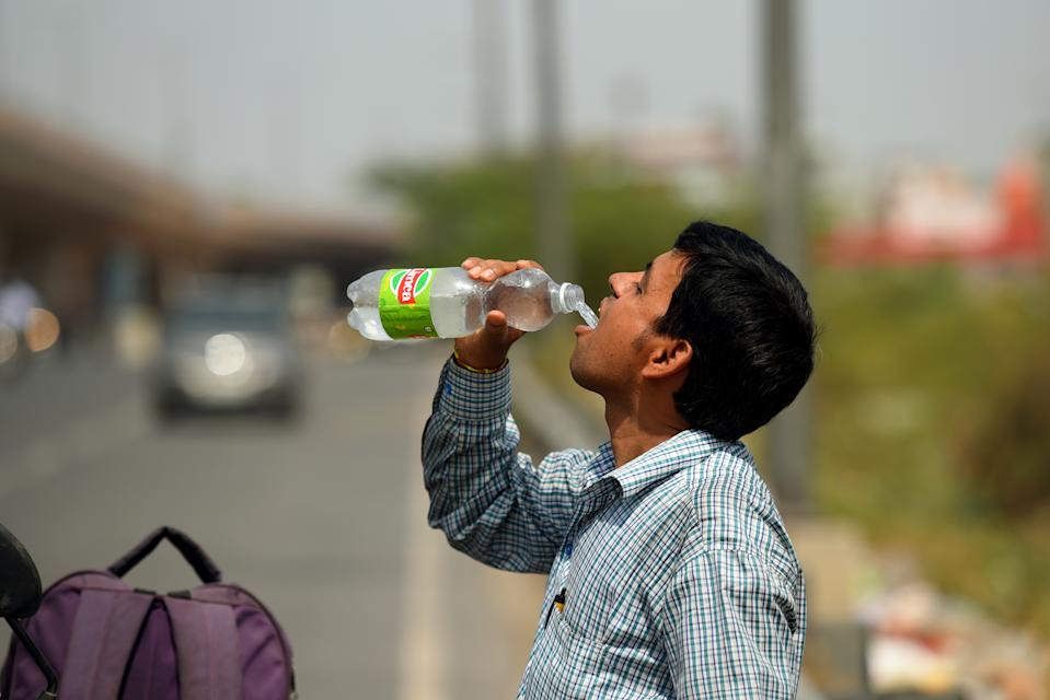 NEW DELHI, INDIA - JUNE 10: A man drinks water from a bottle on a hot summer day on June 10, 2019 in New Delhi, India. The mercury shattered all records in Delhi NCR on Monday with parts of the national capital region recording an all-time high of 48 degrees Celsius for the month of June. (Photo by Amal KS/Hindustan Times via Getty Images)