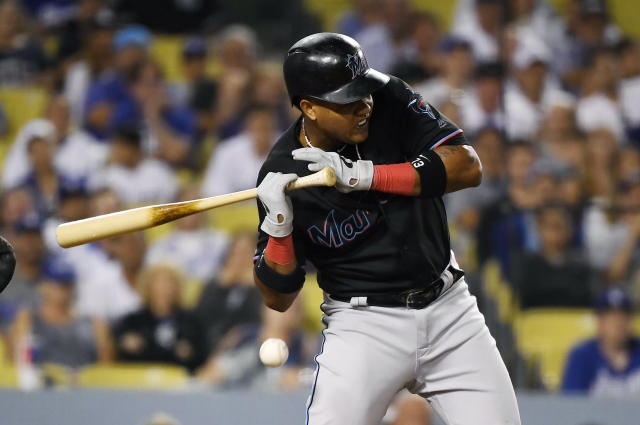 Miami Marlins' Starlin Castro is hit in the hand by a pitch during the eighth inning of a baseball game against the Los Angeles Dodgers Saturday, July 20, 2019, in Los Angeles. (AP Photo/Mark J. Terrill)