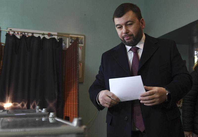 Acting leader of the self-proclaimed Donetsk People's Republic Denis Pushilin casts his ballot at a polling station during rebel elections in Donetsk, Ukraine, Sunday, Nov. 11, 2018. Residents of the eastern Ukraine regions controlled by Russia-backed separatist rebels are voting for local governments in elections denounced by Kiev and the West. (AP Photo)