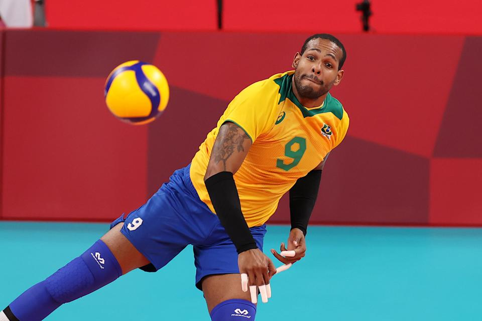 TOKYO, JAPAN - AUGUST 01: Yoandy Leal Hidalgo #9 of Team Brazil serves against Team France during the Men's Preliminary Round - Pool B volleyball on day nine of the Tokyo 2020 Olympic Games at Ariake Arena on August 01, 2021 in Tokyo, Japan. (Photo by Toru Hanai/Getty Images)