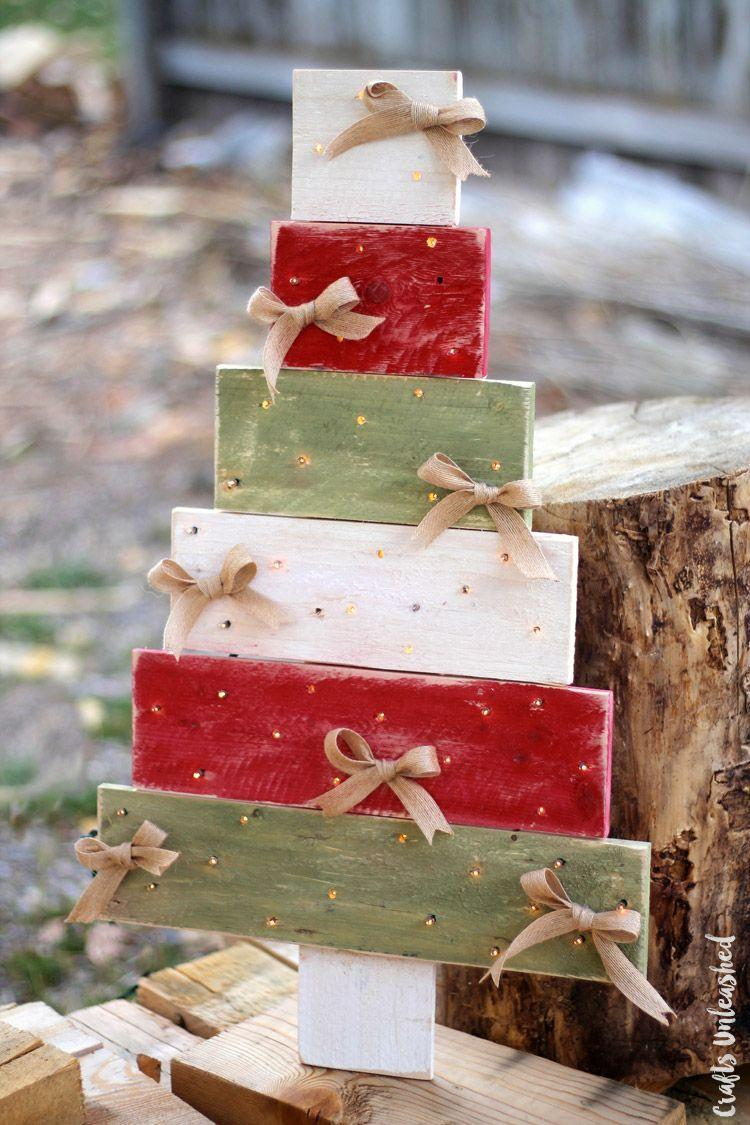 """<p>For this project, ideal for non-woodworkers, purchase a premade pallet tree and then decorate with lights and bows to your heart's content.</p><p><strong>Get the tutorial at <a href=""""http://blog.consumercrafts.com/seasonal/winter/christmas/pallet-wood-diy-tree/"""" rel=""""nofollow noopener"""" target=""""_blank"""" data-ylk=""""slk:Crafts Unleashed"""" class=""""link rapid-noclick-resp"""">Crafts Unleashed</a>.</strong></p><p><strong><a class=""""link rapid-noclick-resp"""" href=""""https://www.amazon.com/s?k=natural+jute+ribbon&i=arts-crafts&ref=nb_sb_noss_1&tag=syn-yahoo-20&ascsubtag=%5Bartid%7C10050.g.23322271%5Bsrc%7Cyahoo-us"""" rel=""""nofollow noopener"""" target=""""_blank"""" data-ylk=""""slk:SHOP NATURAL JUTE RIBBON"""">SHOP NATURAL JUTE RIBBON</a><br></strong></p>"""