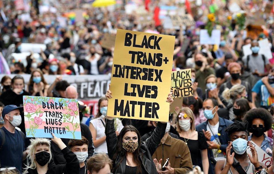People take part in a Black Trans Lives Matter rally in London, Britain, June 27, 2020.