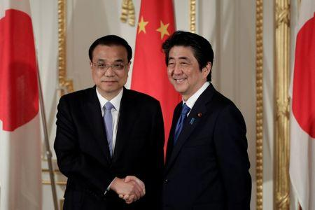 Japan, China hail warming ties amid troubled history