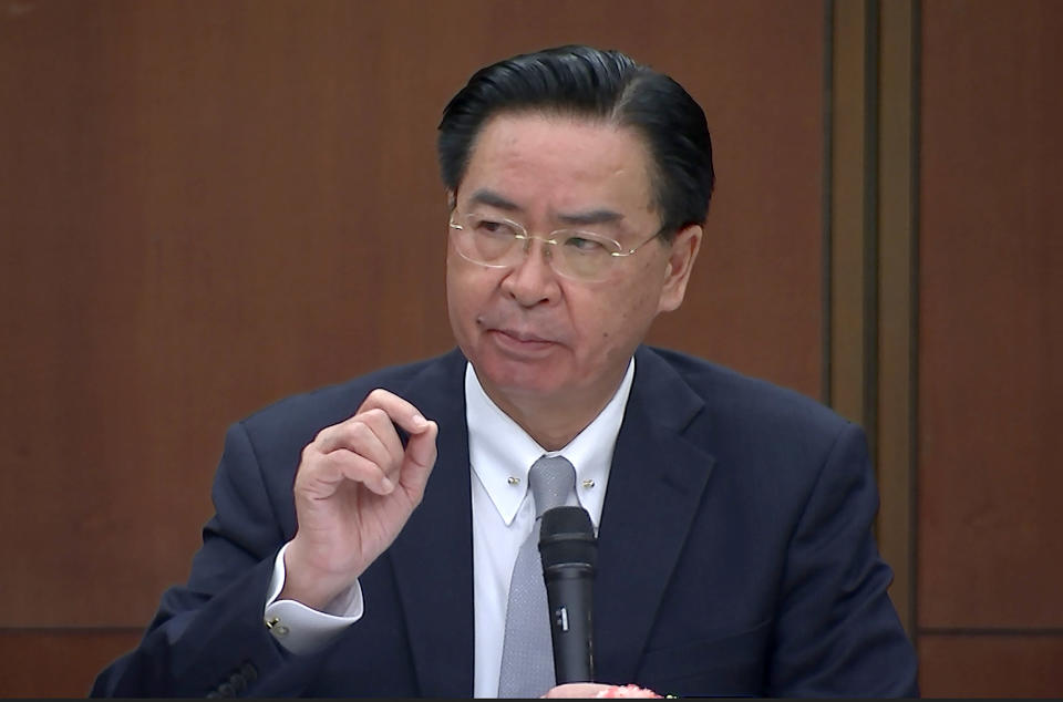 "Taiwanese Foreign Minister Joseph Wu speaks during a briefing Wednesday, April 7, 2021, in Taipei, Taiwan. Wu said that China's attempts at conciliation and military intimidation are sending ""mixed signals"" to people on the island China claims as its own territory to be won over peacefully or by force. (AP Photo/Wu Taijing)"