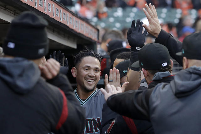 Arizona Diamondbacks' Ildemaro Vargas, center, is congratulated by teammates after hitting a solo home run against the San Francisco Giants during the first inning of a baseball game in San Francisco, Friday, May 24, 2019. (AP Photo/Jeff Chiu)
