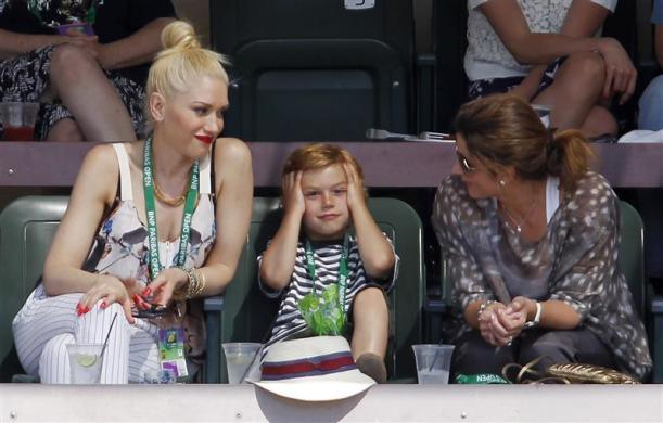 Gwen Stefani and Mirka Federer, the wife of Roger Federer of Switzerland, look at Stefani's son Kingston Rossdale as they sit in a stadium suite during the Indian Wells ATP tennis tournament in California, March 16, 2012.