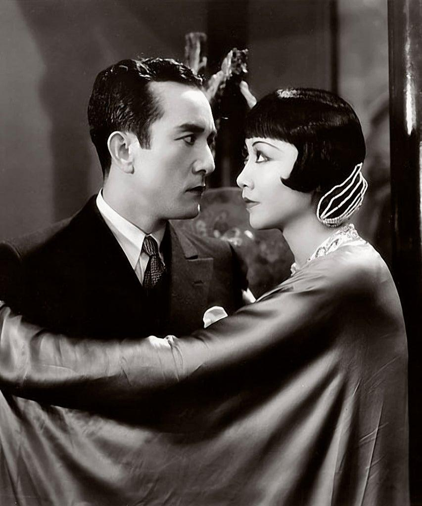 """Actress Anna May Wong and Sessue Hayakawa with Harold Minjir in a scene from the movie """"Daughter of the Dragon"""" (Photo by Donaldson Collection/Getty Images)"""