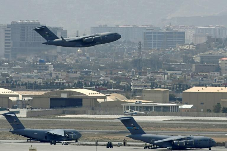 A US Air Force aircraft takes off from the airport in Kabul (AFP/Aamir QURESHI)