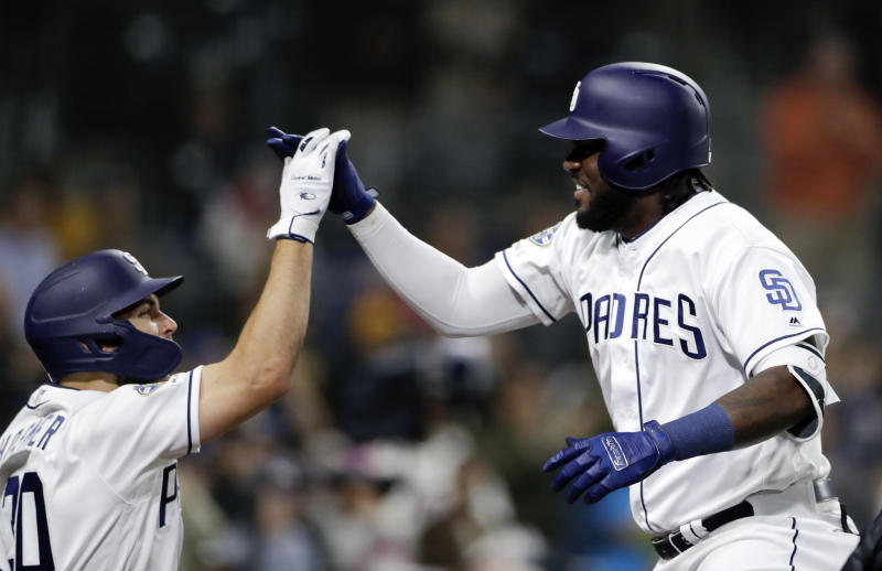 San Diego Padres' Franmil Reyes, right, celebrates with teammate Eric Hosmer, left, after hitting a two-run home run during the sixth inning of a baseball game against the Arizona Diamondbacks, Monday, May 20, 2019, in San Diego. (AP Photo/Gregory Bull)