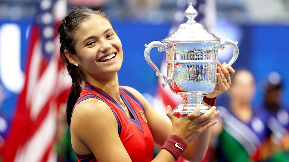 Pictured here, Emma Raducanu smiles with delight after winning the US Open title in 2021.