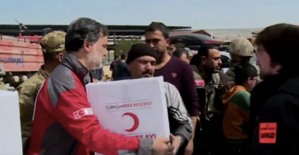 """<p>The Turkish Red Crescent began distributing aid in downtown Afrin, in northern Syria, on Tuesday, March 20.</p><p>On Sunday, Turkish forces and their Syrian rebel allies raised their flags over Afrin, declaring full control of the northern Syrian town after an eight-week campaign to drive Kurdish <span class=""""caps"""">YPG</span> forces, reported <a href=""""https://www.reuters.com/article/us-mideast-crisis-syria-afrin/turkish-forces-and-syrian-allies-drive-kurds-from-afrin-idUSKCN1GU07P"""" target=""""_blank"""">Reuters</a>.</p><p>On Monday, while calling for improved access to the civilians in Afrin, International Committee of the Red Cross (<span class=""""caps"""">ICRC</span>) <a href=""""https://www.reuters.com/article/us-mideast-crisis-syria-afrin-redcross/icrc-calls-for-access-to-syrian-kurds-in-afrin-idUSKBN1GV124"""" target=""""_blank"""">President Peter Maurer said</a> """"the credibility of a Turkish Red Crescent working in Afrin with the Kurdish population is close to zero.""""</p><p>Maurer's comments were condemned by <a href=""""https://aa.com.tr/en/middle-east/ankara-blasts-claims-about-red-crescent-aid-in-afrin/1094491"""" target=""""_blank"""">Hami Aksoy</a>, a Turkish Foreign Ministry spokesman, who said the comments were """"unacceptable"""" and """"divorced from the truth."""" Credit: The Turkish Red Crescent via Storyful</p>"""