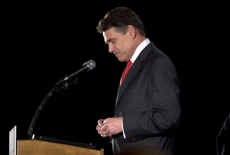 Republican presidential candidate, Texas Gov. Rick Perry pauses on caucus night Tuesday, Jan. 3, 2012, in West Des Moines, Iowa.  (AP Photo/Evan Vucci)