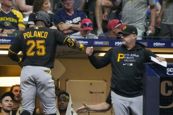 Pittsburgh Pirates' Gregory Polanco is congratulated after hitting a home run during the sixth inning of a baseball game against the Milwaukee Brewers Friday, June 11, 2021, in Milwaukee. (AP Photo/Morry Gash)