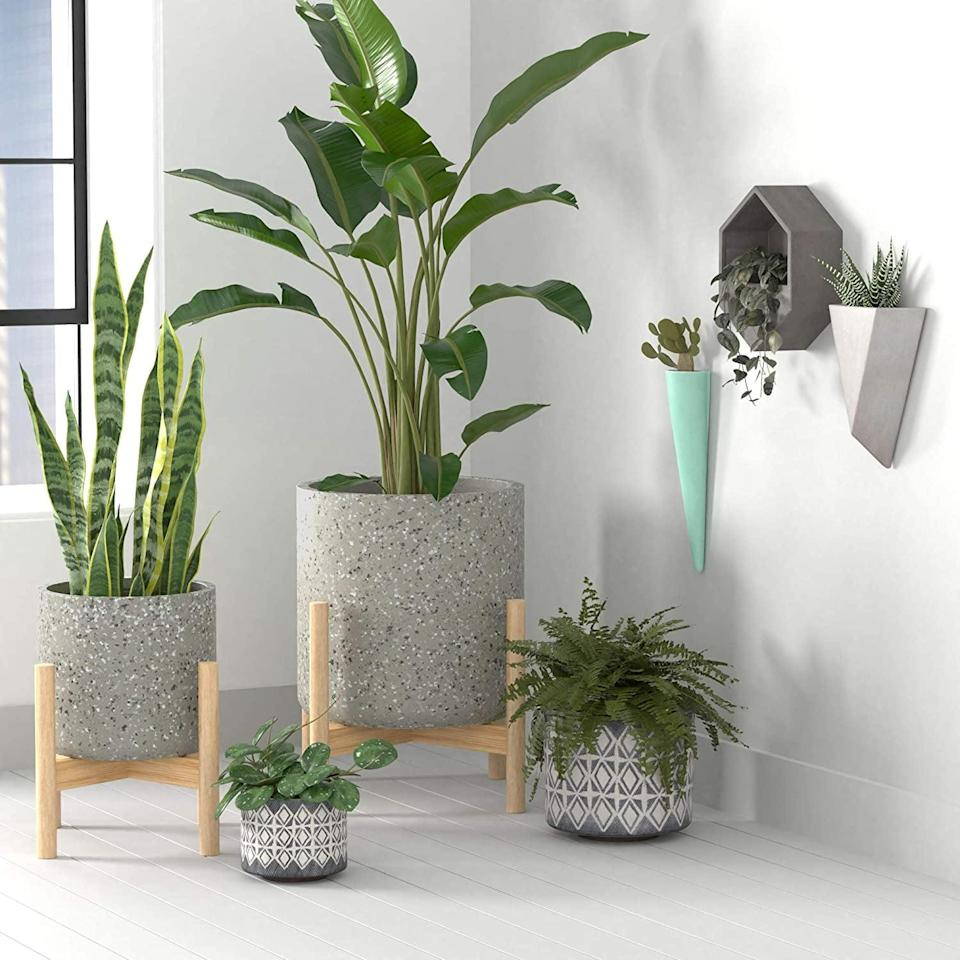<p>This <span>Rivet Terrazzo Planter with Wood Stand</span> ($75) looks like those cool ones on Instagram.</p>