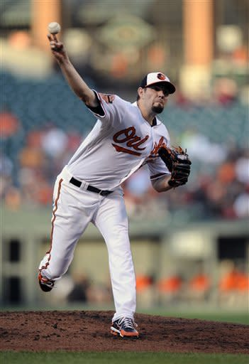 Baltimore Orioles starting pitcher Jason Hammel delivers against the Los Angeles Angels during the second inning of a baseball game on Wednesday, June 27, 2012, in Baltimore. (AP Photo/Nick Wass)