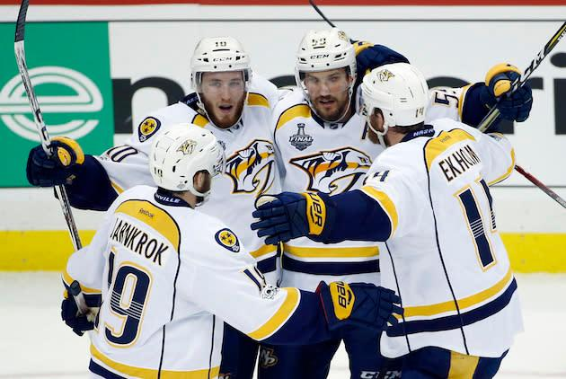 "<a class=""link rapid-noclick-resp"" href=""/nhl/teams/nas/"" data-ylk=""slk:Nashville Predators"">Nashville Predators</a>' <a class=""link rapid-noclick-resp"" href=""/nhl/players/5739/"" data-ylk=""slk:Colton Sissons"">Colton Sissons</a>, left rear, celebrates with teammates after scoring a goal against the Pittsburgh Penguinsduring the third period in Game 1 of the NHL hockey Stanley Cup Finals, Monday, May 29, 2017, in Pittsburgh. (AP Photo/Gene J. Puskar)"
