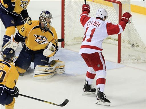 Detroit Red Wings right wing Danny Cleary (11) begins to celebrate his goal against Nashville Predators goalie Pekka Rinne (35), of Finland, in the second period of an NHL hockey game Monday, Dec. 26, 2011, in Nashville, Tenn. (AP Photo/Mark Humphrey)