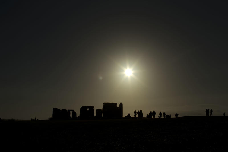 "People are silhouetted as the sun rises above the ancient stone circle of Stonehenge, in southern England, as access to the site is given to druids, New Age followers and members of the public on the annual Winter Solstice, Friday, Dec. 21, 2012.  Doomsday hour is here and so still are we.  According to legend, the ancient Mayans' long-count calendar ends at midnight Thursday, ushering in the end of the world. Didn't happen.  ""This is not the end of the world. This is the beginning of the new world,"" Star Johnsen-Moser, an American seer, said at a gathering of hundreds of spiritualists at a convention center in the Yucatan city of Merida, an hour and a half from the Mayan ruins at Chichen Itza. (AP Photo/Matt Dunham)"
