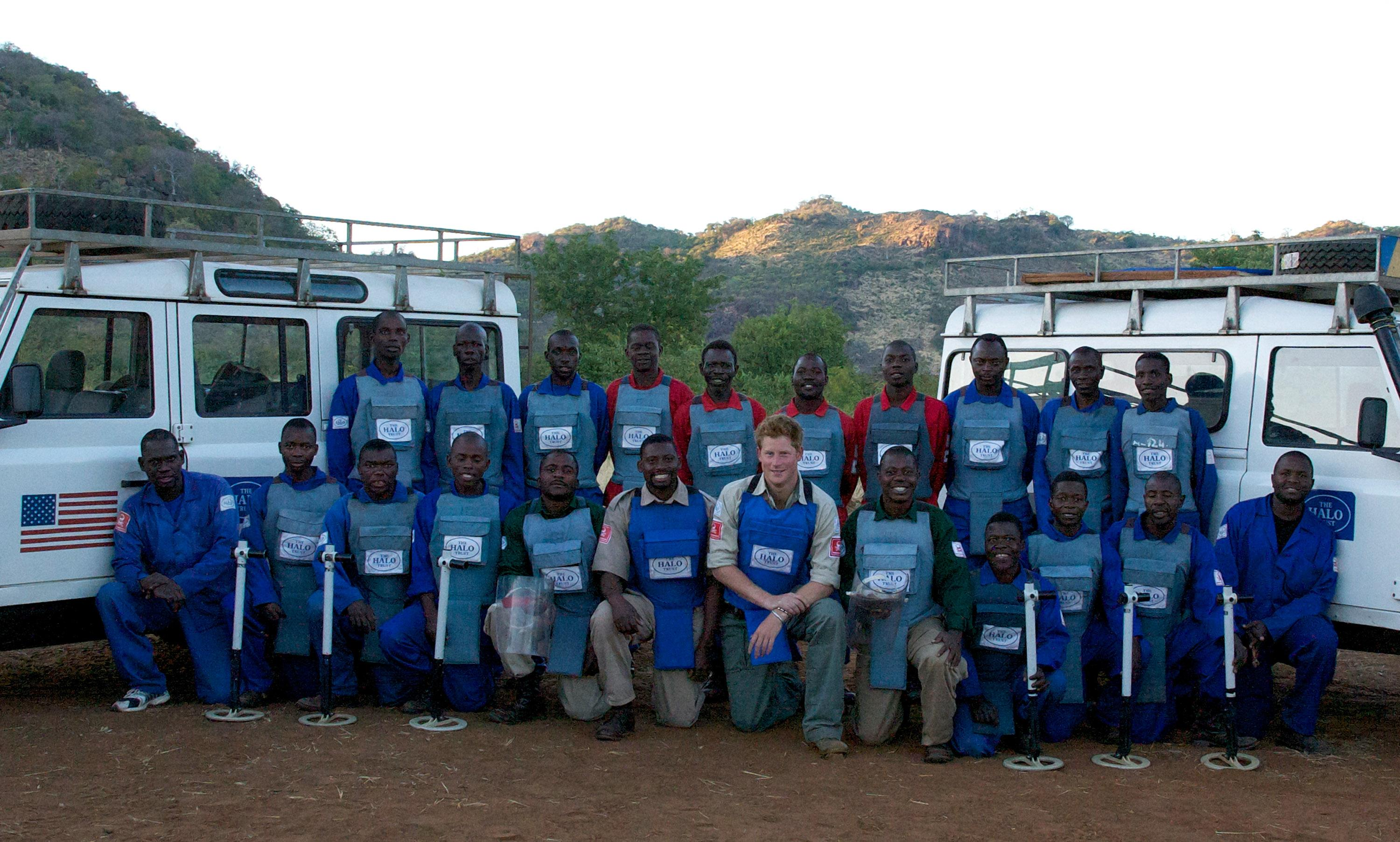 Prince Harry is seen with deminers from The HALO Trust, a British charity dedicated to removal of landmines, on June 21, 2010 in Cahora Bassa, Mozambique [Photo: Getty]